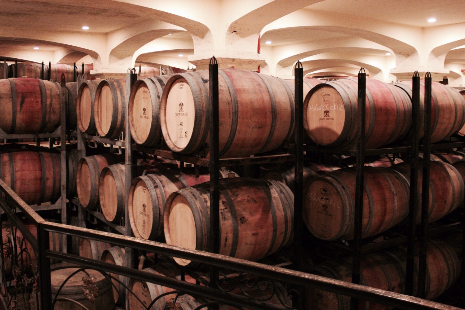 Oak barrels at Grace Vineyard